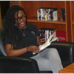 Student Sitting Library